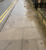 Pavement damaged, uneven and sinking on West Street