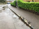 Dislodged cobble kerbs outside Willow House on Weedon Road in Farthingstone